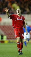 Photo. Andrew Unwin.Digitalsport<br /> Middlesbrough v Leicester City, Barclaycard Premier League, Riverside Stadium, Middlesbrough 17/01/2004.<br /> Middlesbrough's Danny Mills apologises after running into the linesman.