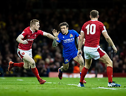Matteo Minozzi of Italy under pressure from  Johnny McNicholl of Wales<br /> <br /> Photographer Simon King/Replay Images<br /> <br /> Six Nations Round 1 - Wales v Italy - Saturday 1st February 2020 - Principality Stadium - Cardiff<br /> <br /> World Copyright © Replay Images . All rights reserved. info@replayimages.co.uk - http://replayimages.co.uk
