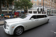 Stretch limousine Rolls Royce in Knightsbridge, London, UK. IN this wealthy part of West London, examples of extreme wealth and exclusive lifestyle are oppulantly on show everywhere you look. The choice of what car you drive or what clothes you wear all gives off an appearance of your rich status.