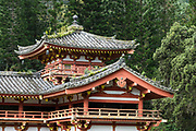 """The peaceful Byodo-In Temple is in Valley of the Temples Memorial Park, at 47-200 Kahekili Highway, Kaneohe, on the island of Oahu, Hawaii, USA. The Byodo-In Temple (""""Temple of Equality"""") was built in 1968 to commemorate the 100 year anniversary of the first Japanese immigrants to Hawaii. This Hawaii State Landmark is a non-practicing Buddhist temple which welcomes people of all faiths. The beautiful grounds at the foot of the Ko'olau Mountains include a large reflecting pond stocked with Japanese koi carp, meditation niches, and small waterfalls. Byodo-In Temple in O'ahu is a half-scale replica of the original Byodo-in Temple built in 1053 in Uji, Japan (a UNESCO World Heritage Site)."""