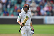 Wicket - Rory Burns of Surrey looks at his bat as he walks back to the pavilion after being dismissed by Tim Groenewald of Somerset during the opening day of the Specsavers County Champ Div 1 match between Somerset County Cricket Club and Surrey County Cricket Club at the Cooper Associates County Ground, Taunton, United Kingdom on 18 September 2018.