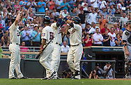 Brian Dozier #2 of the Minnesota Twins celebrates with teammates Oswaldo Arcia #31 and Clete Thomas #11 after hitting a home run against the Chicago White Sox on June 19, 2013 at Target Field in Minneapolis, Minnesota.  The Twins defeated the White Sox 7 to 4.  Photo: Ben Krause