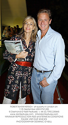 ROBERT & KIM HERSOV  at a party in London on 11th September 2003.PMI 285