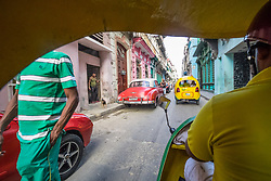 "View from inside a ""coco-taxi"" in Havana."