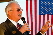 19 MAY 2011 - PHOENIX, AZ: State Represenative John Kavanagh speaks against a backdrop of an American flag in Paradise Valley Park in Phoenix Thursday evening. About 100 people attended the rally, which was to support some of the state's most conservative politicians including Joe Arpaio, Russell Pearce and John Kavanagh. The rally was sponsored by the Maricopa County Republican Party and a Tea Party group.     PHOTO BY JACK KURTZ