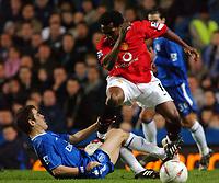 Photo. Daniel Hambury, Digitalsport<br /> Chelsea v Manchester United. 12/1/2005.<br /> Carling Cup Semi Final. First Leg.<br /> Chelsea's Joe Cole gets it where it hurts from Manchester United's Eric Djemba-Djemba