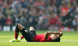 Manchester United's Jesse Lingard lies injured on the pitch