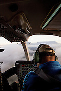 A pilot in a helicopter flies towards the huge, flat topped Mount Roraima above the Gran Sabana in Venezuela