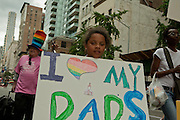 "A young girl with a sign saying ""I love my Dads"" in the 2011 Pride Parade on New York's Fifth Avenue."