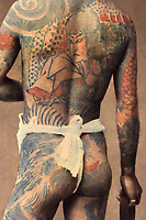 Japanese tattoos have a long tradition and each tattoo has a meaning.  Tattoos show a person's status in society, though these days that status is usually not so good.  The interesting thing about Japanese Tattoos is they are both clandestine and artistic at the same time.  Some people have tattoos as a protective charm or as a symbol of devotion.  What makes them unique is the combination of many features in the overall design.  The dragon is perceived as a powerful force - unlike in western cultures where a dragon is considered to be a terrifying creature.  Tatoos also convey personal beliefs, character traits or aspirations.  The symbol of a peony is a sign of wealth, elegance and prosperity.  The rose is the king of flowers and a sign of strong character.  These days tattoos are usually only worn by yakuza gangsters and are frowned upon in society - so much so that bathers with tattoos are usually banned from entry.  Whether that makes them more fascinating or not, is up to the beholder.
