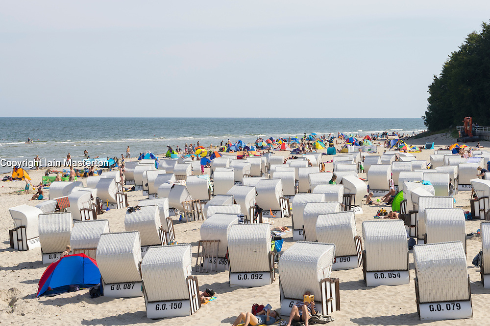 Many traditional Strandkorb beach chairs on beach at Sellin resort on  Rugen Island , Mecklenburg-Vorpommern Germany