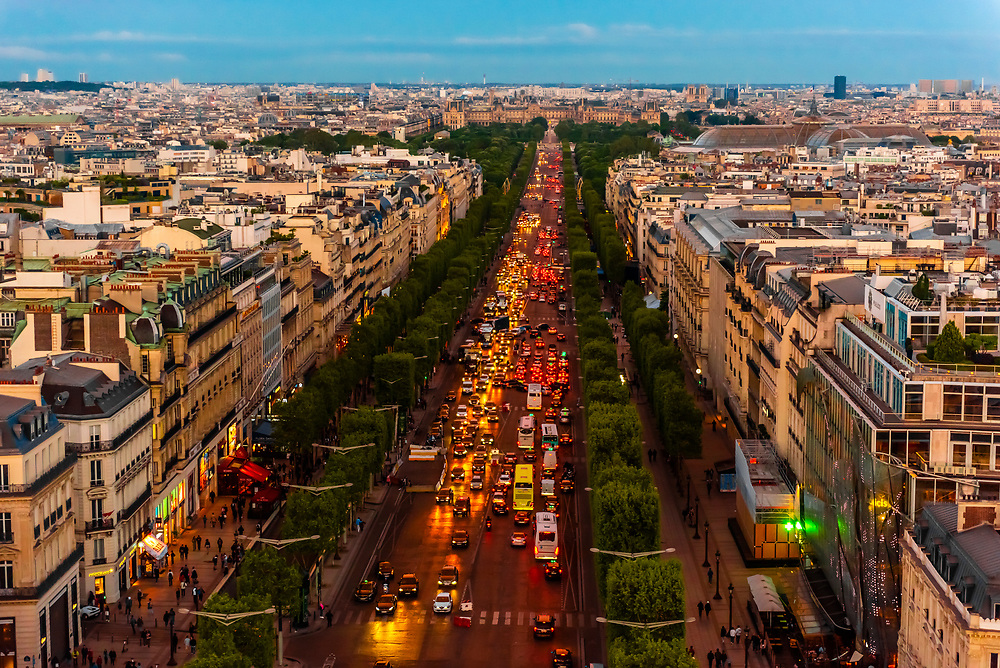 Traffic at twilight along the Champs Elysees, looking from Place de l'Etoile to Place de la Concorde, Paris, France.