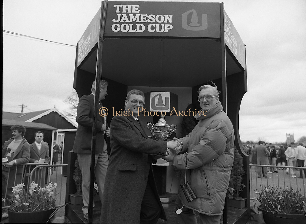 Irish Grand National At Fairyhouse.  (R54)..1987..20.04.1987..04.20.1987..20th April 1987..The Easter Racing Festival at Fairyhouse included the running of the Jameson sponsored Irish Grand National. Another featured race was the Jameson Gold Cup which was also run on Easter Monday...Mr John Mulhern, Celbridge,Co Kildare, Trainer of 'Wolf of Badenoch' is pictured being presented with the Jameson Gold Cup by Mr Bob Burton, Jameson's Irish Whiskey Club.