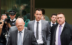© London News Pictures. 13/07/2012. London, UK. England Footballer and Chelsea FC Captain JOHN TERRY (centre) leaving Westminster Magistrates court, escorted by security on July 13, 2012, where a verdict  of not guilty was returned  today in John Terry's trial for allegedly using a racist obscenity about Queens Park Rangers player Anton Ferdinand. Photo credit: Ben Cawthra/LNP.
