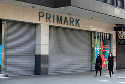 © Licensed to London News Pictures. 23/03/2021. London, UK. Women wearing protective face coverings walk past a branch of Primark in Wood Green, north London on the anniversary of the first Covid-19 lockdown in the UK. Non-essential retail, including Primark, isn't expected to re-open until 12 April. Photo credit: Dinendra Haria/LNP