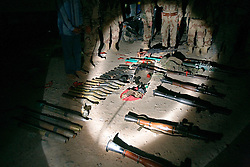 A cache of weapons is seen in Mosul, Iraq, Dec. 12, 2005. The cache consisted of three rocket propelled grenade launchers, two sniper rifles, an anti-tank rocket launcher, a huge pile of ammunition, grenades and rockets. The cache was taken from a van in a parking lot next door to a polling station. Members of the 1st Infantry, 17th Regiment, assisted Iraqi Army Battalion 222, as they planned and executed this raid with the help of an informant. US forces were helping Iraqi forces secure western Mosul in preparation for Iraq's first post-Saddam parliamentary elections. The western sector is home to Mosul's primarily Sunni population, which has been resistant to the American presence in Iraq.