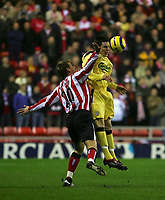 Photo: Andrew Unwin.<br /> Sunderland v Liverpool. The Barclays Premiership.<br /> 30/11/2005.<br /> Liverpool's Steve Finnan (R) competes in the air with Sunderland's Chris Brown (L).