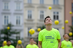 June 14, 2018 - Krakow, Poland - A man practices with a ball before the 'attempt to break the Guiness Record for the most people keeping the ball in the air' in Krakow. According to the organizers the record was beated by 1561 people chipping'' the ball for at least 10 seconds in the air. The event takes place on the opening of the World Cup in Russia. (Credit Image: © Omar Marques/SOPA Images via ZUMA Wire)