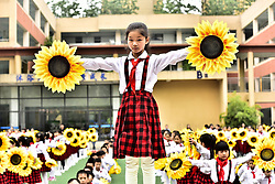 May 3, 2017 - Hefei, Hefei, China - Hefei, CHINA-May 3 2017: (EDITORIAL USE ONLY. CHINA OUT) ..More than 1,700 pupils perform sunflower dance at a primary school in Hefei, east China's Anhui Province, May 3rd, 2017. (Credit Image: © SIPA Asia via ZUMA Wire)
