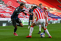 Middlesbrough's Djed Spence plays the ball through the legs of Stoke City's Morgan Fox<br /> <br /> Photographer Alex Dodd/CameraSport<br /> <br /> The EFL Sky Bet Championship - Stoke City v Middlesbrough - Saturday 5th December 2020 - bet365 Stadium - Stoke-on-Trent<br /> <br /> World Copyright © 2020 CameraSport. All rights reserved. 43 Linden Ave. Countesthorpe. Leicester. England. LE8 5PG - Tel: +44 (0) 116 277 4147 - admin@camerasport.com - www.camerasport.com
