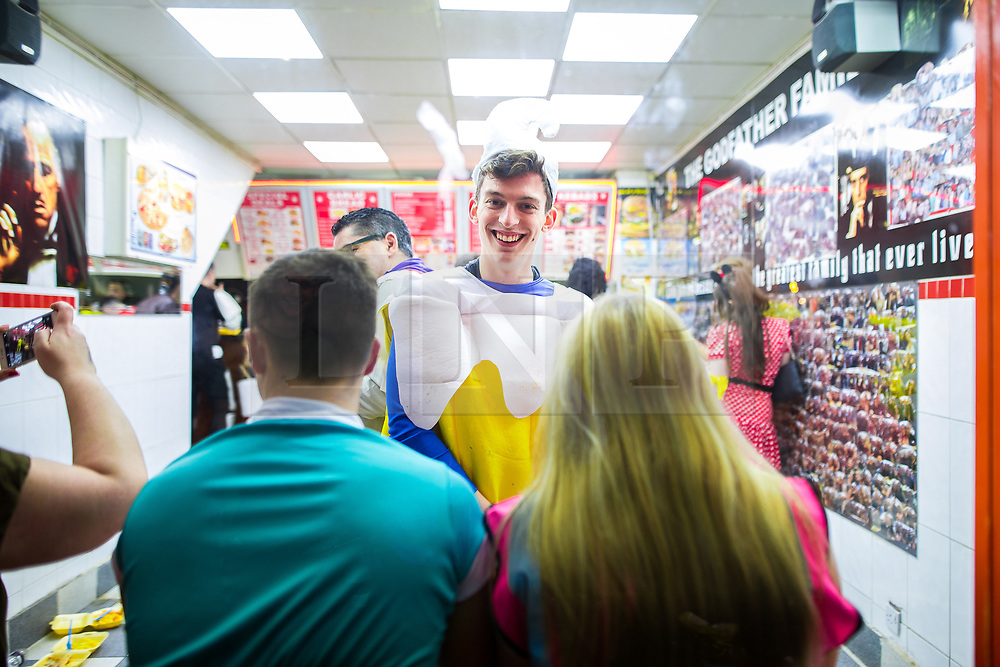 © Licensed to London News Pictures . 27/12/2017. Wigan, UK. Revellers in Wigan enjoy Boxing Day drinks and clubbing in Wigan Wallgate . In recent years a tradition has been established in which people go out wearing fancy-dress costumes on Boxing Day night . Photo credit: Joel Goodman/LNP