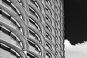 The Walbrook Building between Cannon Street and Bank Underground Station in Black and white. The repetitive round pattern is the distinct reinforced polymer shading.<br /> <br /> Architect: Fosters & Partners