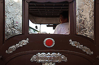 A Filipino calesa driver - Calesas are horse-driven carriages sometimes used in the Philippines. This was one of the modes of transportation introduced in the Philippines in the 18th century by the Spanish - at the time only nobles and high ranked officials could afford. They are rarely used in the streets nowadays except rural areas and especially in Vigan where they are still a common form of transportation.
