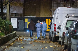 © Licensed to London News Pictures. 05/12/2019. London , UK. Forensic investigators gather evidence in St. John at Hackney Churchyard Gardens approximately 200 meters from the scene of a fatal stabbing in Clarence Mews, Hackney. Police were called at 14:01 GMT and attended alongside London Ambulance Service and London's Air Ambulance where they found a man seriously injured. Despite their best efforts the man - believed to be aged in his 20s - was pronounced dead at the scene at 14:33hrs. Photo credit: Peter Manning/LNP
