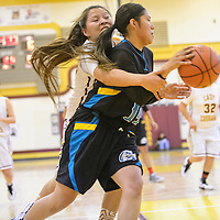 022715       Adron Gardner/Independent<br /> <br /> Tohatchi Cougar Shanell Dawes (34), left, attempts a steal on Navajo Prep Eagle Jazmin Benally (14)  during the district 1AAA championship in Tohatchi Friday.