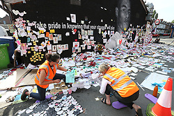 © Licensed to London News Pictures. 23/07/2021. Manchester, UK.  Conservation professionals carefully remove messages left at the mural of Marcus Rashford in Manchester. The messages are to be taken away for preservation, amid worries that they will disintegrate in the rain. Photo credit: Adam Vaughan/LNP