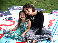 Elika Ashoori At the  photocall the  took place in Parliament Square to mark Nazanin Zaghari-Ratcliffe's 2000th day of being detained in Iran, A giant snakes and ladders board was used to show the ups and downs of Nazanin's case photo by Leigh Bruin