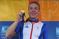 Chris Hoy (GBR) with his 1km Time Trial Gold Medal. Cycling, Athens Olympics, 20/08/2004. Credit: Colorsport/ Matthew Impey DIGITAL FILE ONLY
