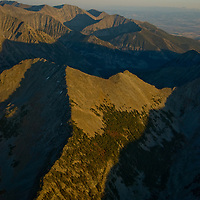 A sunset illuminates the rugged and seldom-visited Crazy Mountains in central Montana near Livingston.