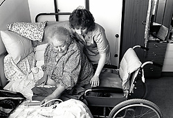 Carer & elderly disabled woman in residential care, Nottingham UK 1991