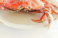A whole Pacific crab on a plate.