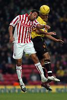Fotball<br /> England 2004/2005<br /> Foto: SBI/Digitalsport<br /> NORWAY ONLY<br /> <br /> Watford v Stoke City Coca Cola Championship.<br /> 04.12.2004<br /> <br /> Carl Asaba of Stoke beats Watford's Gavin Mahon in the air