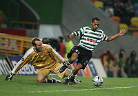 PORTUGAL - LISBOA 17 MARCH 2005: MARK SCHWARZER #1 and LIEDSON #31 in the UEFA Cup knockout phase, match Sporting CP (0) vs Middlesbrough FC (0), held in Alvalade 21 stadium.  17/03/2005  21:57:15<br />(PHOTO BY: GERARDO SANTOS/AFCD)<br /><br />PORTUGAL OUT, PARTNER COUNTRY ONLY, ARCHIVE OUT, EDITORIAL USE ONLY, CREDIT LINE IS MANDATORY AFCD-PHOTO AGENCY 2004 © ALL RIGHTS RESERVED