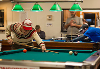 Jim O'Neil sinks the 8 ball to advance into the final round of the Robbie Mills 8-Ball Tournament at the Rod and Gun on Saturday.  (Karen Bobotas/for the Laconia Daily Sun)
