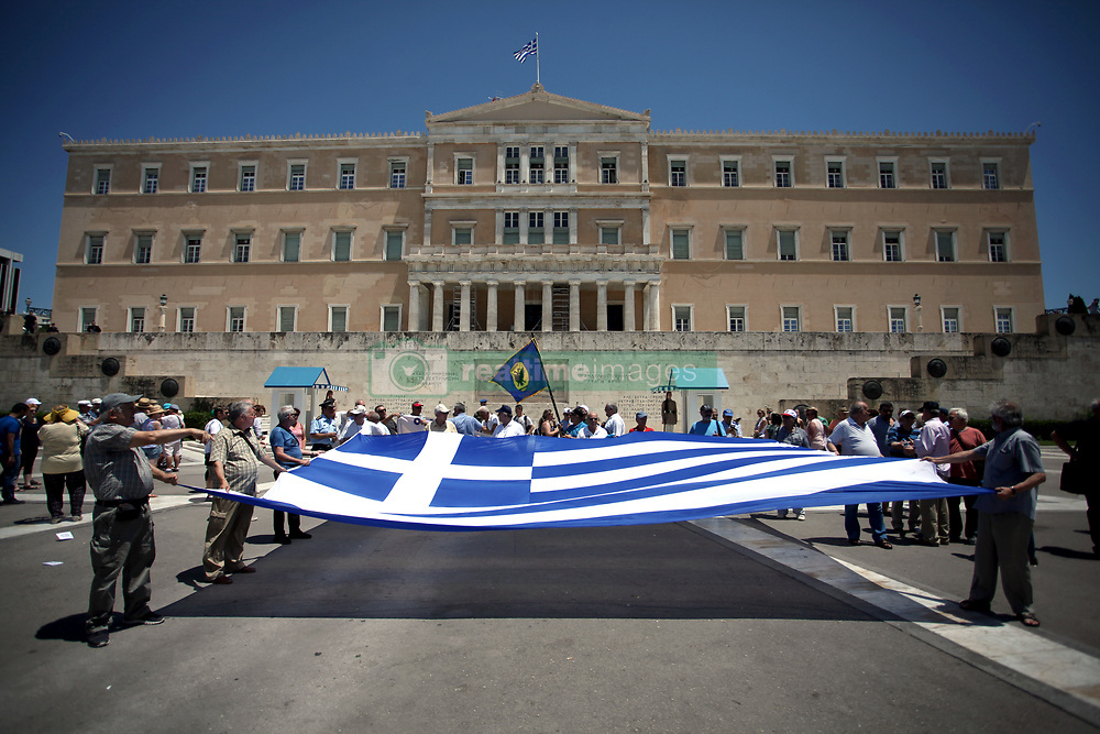 June 14, 2018 - Athens, Greece - Anti-austerity rally in Athens. Greece's parliament approved the last big austerity package of its eight-year bailout program Thursday, preparing the country for its full return to financing itself on bond markets beginning this summer. (Credit Image: © Giorgos Georgiou/NurPhoto via ZUMA Press)