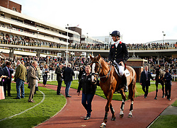 Equine superstars William Fox Pitt on Chilli Morning in the paddock during the April Meeting at Cheltenham Racecourse