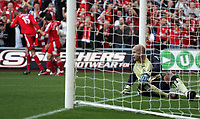 Photo: Paul Thomas.<br /> Liverpool v Blackburn Rovers. The Barclays Premiership. 14/10/2006.<br /> <br /> Brad Friedel (R) of Blackburn gets up out of his goal as Liverpool celebrate Craig Bellamy's goal.