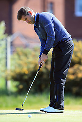 England's Robert Rock on the 1st green during day three of the Betfred British Masters at Hillside Golf Club, Southport.