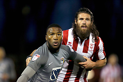Coventry City's Duckens Nazon holds off Lincoln City's Michael Bostwick