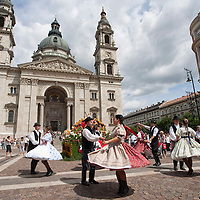 Folk dancers perform their traditional dances during the advertising festival of the Debrecen Flower Carnaval held at St Steven square in Budapest, Hungary. Saturday, 11. July 2009. ATTILA VOLGYI