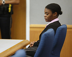 April 30, 2019 - Lawrenceville, GA, USA - Tiffany Moss shows little reaction to the sentencing verdict on Tuesday, April 30, 2019, in Lawrenceville, Ga. The jury sentenced her to death after they found Moss, who is representing herself, guilty of intentionally starving her 10-year-old stepdaughter Emani to death in the fall of 2013, in addition to other charges. (Credit Image: © TNS via ZUMA Wire)