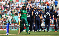 Bangladesh's Soumya Sarkar walks off after being caught out by England's Jonny Bairstow, bowled by Ben Stokes during the ICC Champions Trophy, Group A match at The Oval, London.