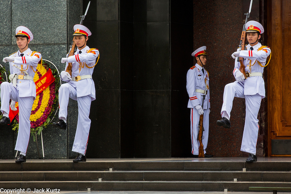08 APRIL 2012 - HANOI, VIETNAM:    The changing of the honor guard at the Ho Chi Minh Mausoleum in Hanoi. The Ho Chi Minh Mausoleum, in Vietnamese: Lng Ch tch H Chí Minh, is a large memorial in Hanoi, Vietnam dedicated to Ho Chi Minh, the late leader of North Vietnam. It is located in the centre of Ba Dinh Square, which is the place where Ho read the Declaration of Independence on September 2, 1945, establishing the Democratic Republic of Vietnam. The mausoleum is 21.6 metres high and 41.2 metres wide.     PHOTO BY JACK KURTZ