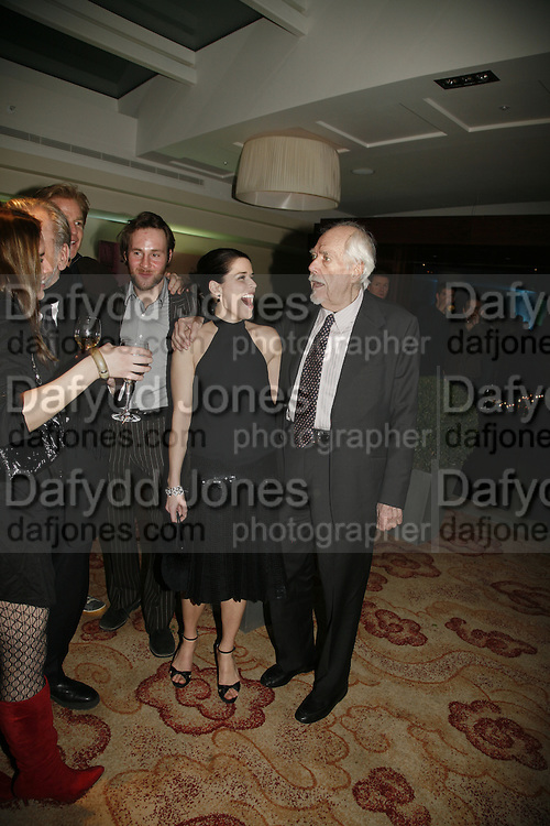 NEVE CAMPBELL AND ROBERT ALTMAN. The party for 'Resurrection Blues' following the opening at the Old Vic. The Riverbank Park Plaza Hotel, London.3 March 2006. ONE TIME USE ONLY - DO NOT ARCHIVE  © Copyright Photograph by Dafydd Jones 66 Stockwell Park Rd. London SW9 0DA Tel 020 7733 0108 www.dafjones.com