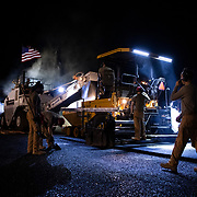 U.S. Air Force RED HORSE take advantage of the cooler temperatures at night to pave an access ramp to the flight line at Air Base 201 in Agadez, Niger, June 28 2019. The flight line construction is the largest U.S. Air Force-led construction project in recent history and will expand the Air Force's ability to bring air power to western Africa. (U.S. Air Force photo by Tech. Sgt. Perry Aston)