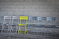 Bright yellow chair at the High Line Park in New York City.